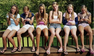 5 teens on phone 1 without she may get vibrating syndrome